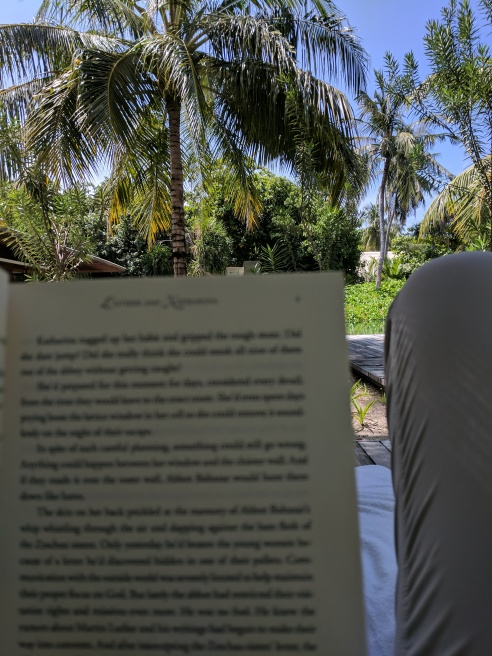 Reading by the pool.